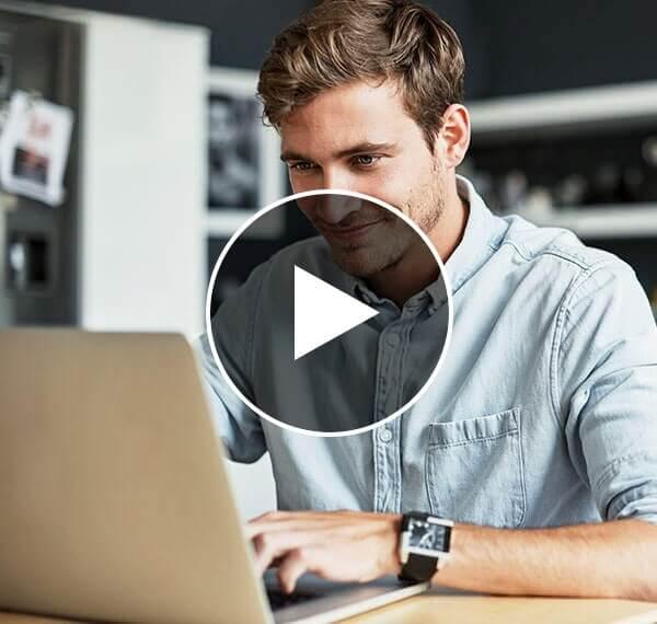 Man sitting at laptop-video